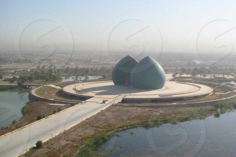 blue round concrete building under clear blue sky photo