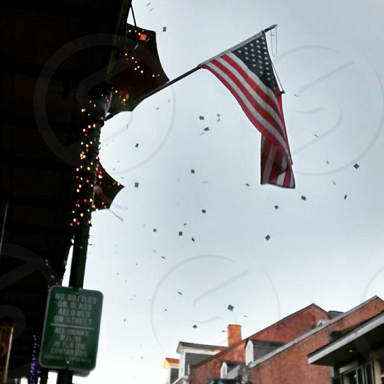 American Flag on a balcony in New Orleans confetti photo