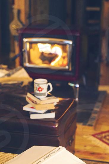 reading fireplace books  photo