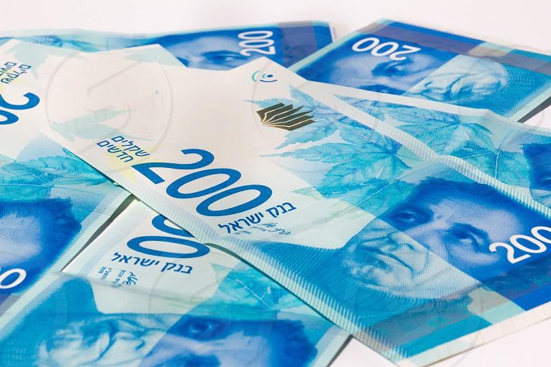 Stack of Israeli money bills of 200 shekel. photo