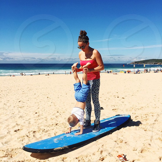 Mother having fun with son on the beach photo