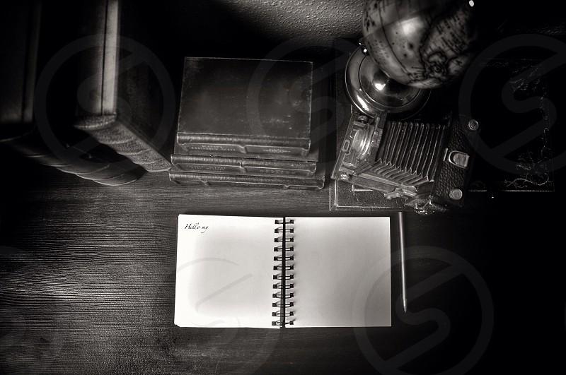 open spiral notebook beside white pen photo