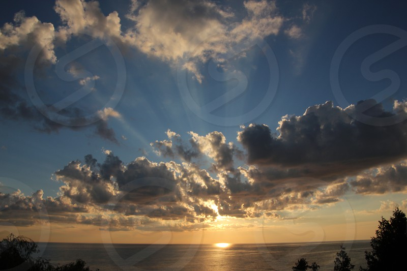 Lake Huron sunset with clouds and rays of light photo