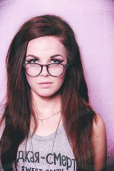 A pink centric fashion shoot. Pink makeup background eyes glasses brunette sass stare beautiful photo