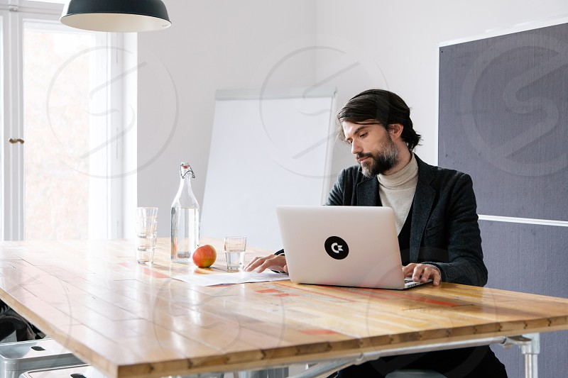 A small startup team working in a modern office space in Berlin.  photo