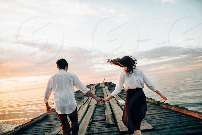 Lovers on pier  photo