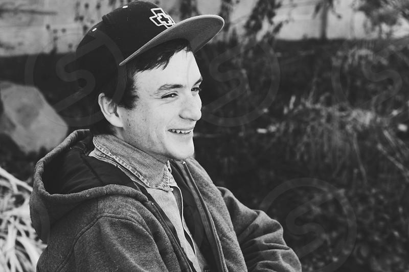 man in gray hoodie smiling photo