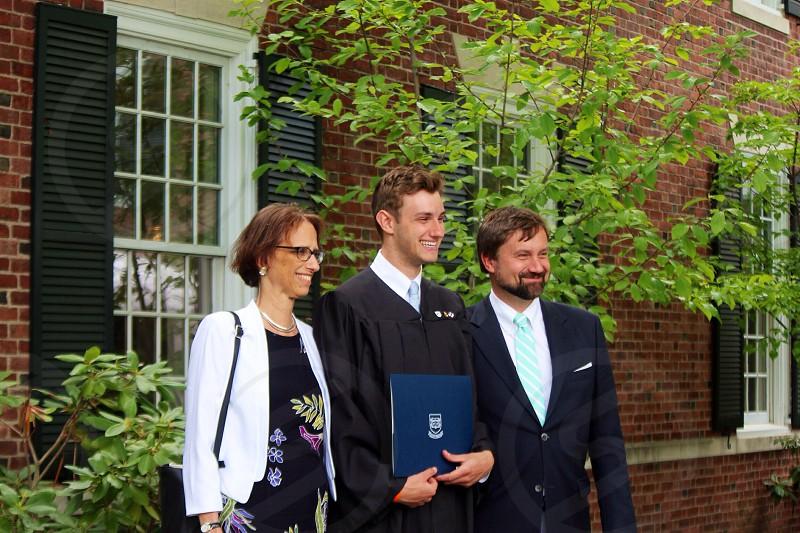 man wearing black graduation toga smiling photo