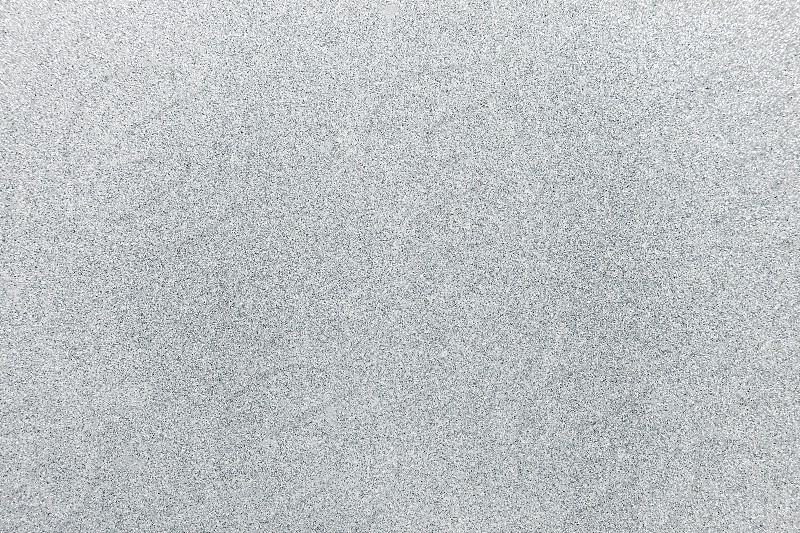Close-up white abstract glitter shimmer background with surface texture detail photo