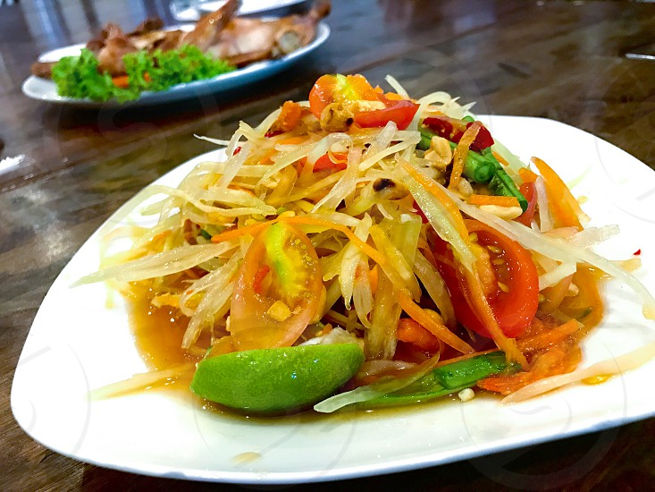 somtum somtam papaya spicy thaifood Thai food northeast cuisine delicious yummy tomato lemon green salad Thailand culture eat restaurant street streetfood photo