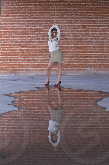 Reflection water industrial brick wall hair style model portrait face makeup woman female photo