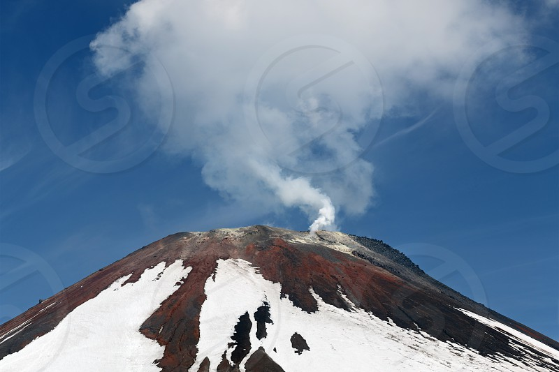 Avacha Volcano - active volcano of Kamchatka Peninsula. View of top of volcanic cone fumarolic activity of volcano: steam and gas emissions from crater. Russia Far East. photo