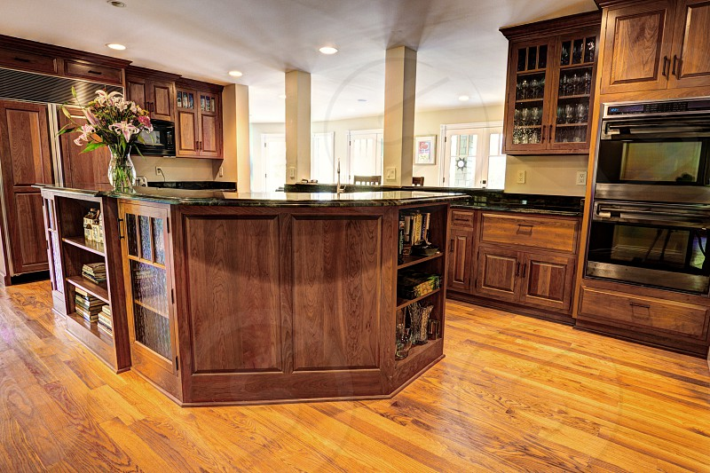 wooden kitchen cabinets and black countertops photo