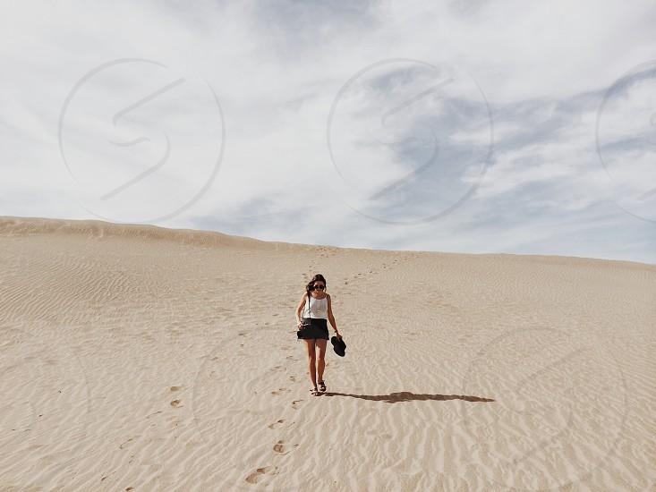 woman standing in desert photo