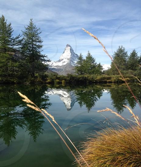 lake near snow covered mountain photo