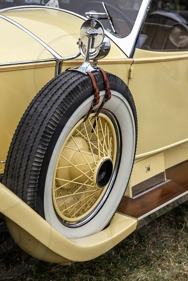 Spare Wheel on a Vintage Yellow Rolls Royce photo