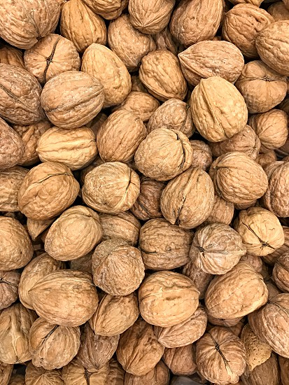 Aerial view of light brown shelled almonds photo