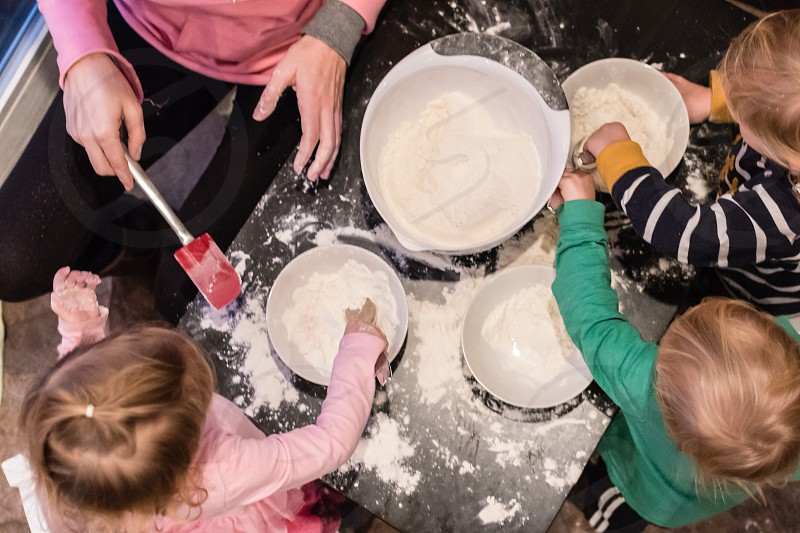 Aerial view of children helping mix ingredients photo