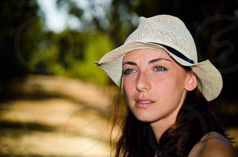 woman in white and black bucket hat photo