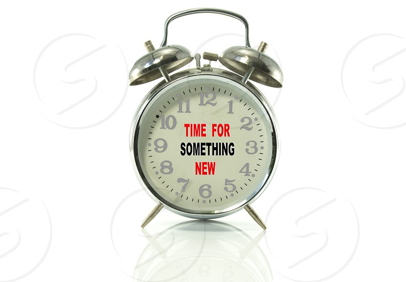 metal alarm clock with text try something new  photo