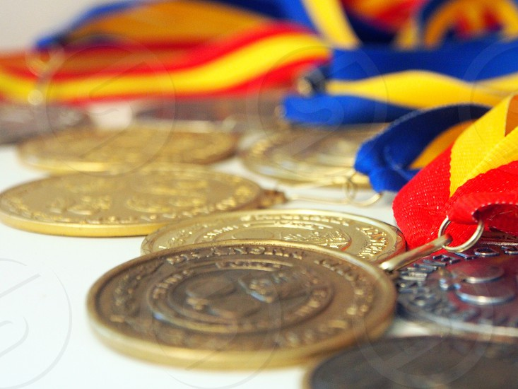 pile of brass medals photo