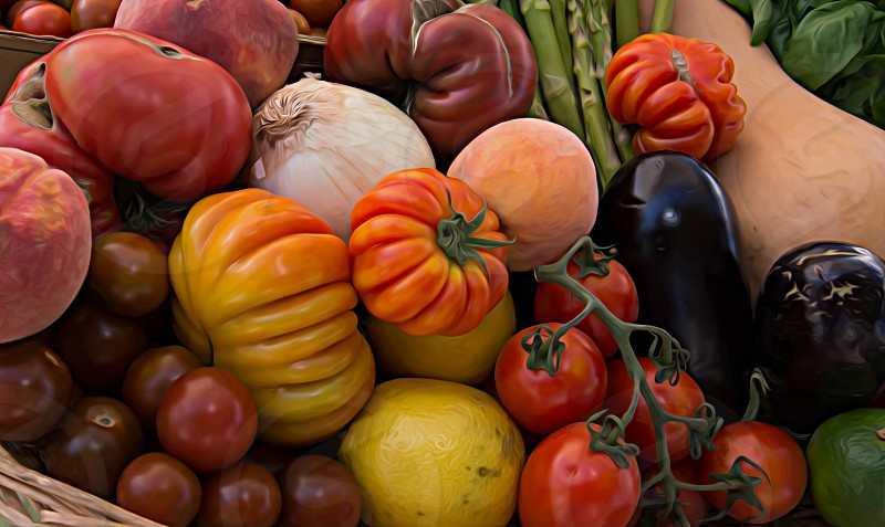 Heirloom Tomatoes in a basket with other fruits and vegetables at the local Farmers' Market in Tucson Arizona Photographed by Michael P. Moriarty photo