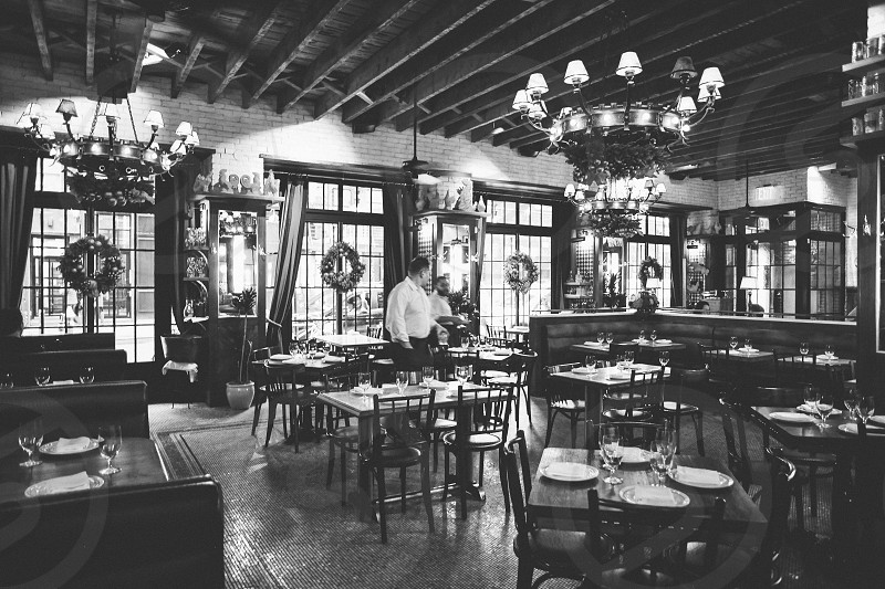 inside dirty french nyc restaurant with waiter facing front windows photo