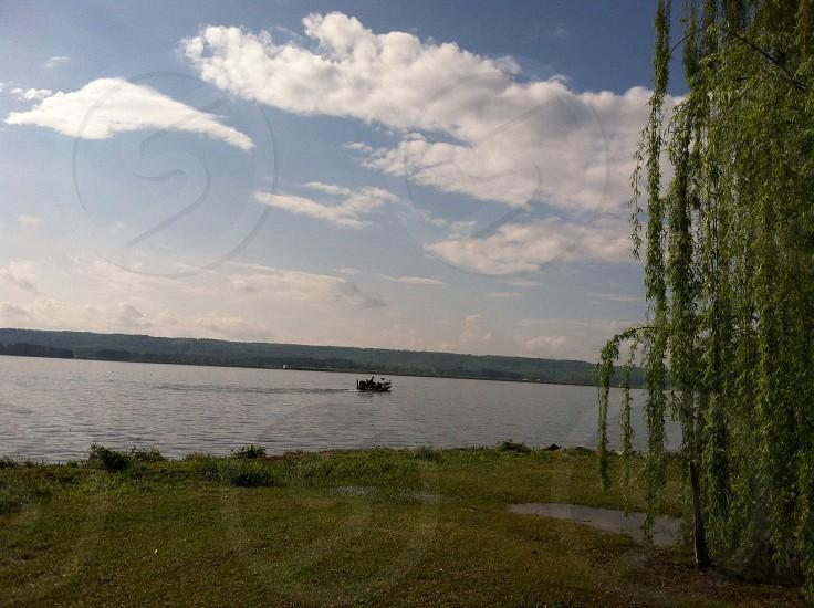 black boat on a lake photo