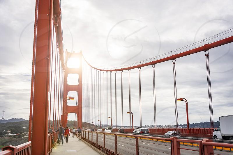 San Francisco California USA October 2016: people walking across the pedestrian path on the Golden Gate Bridge in San Francisco California United States photo