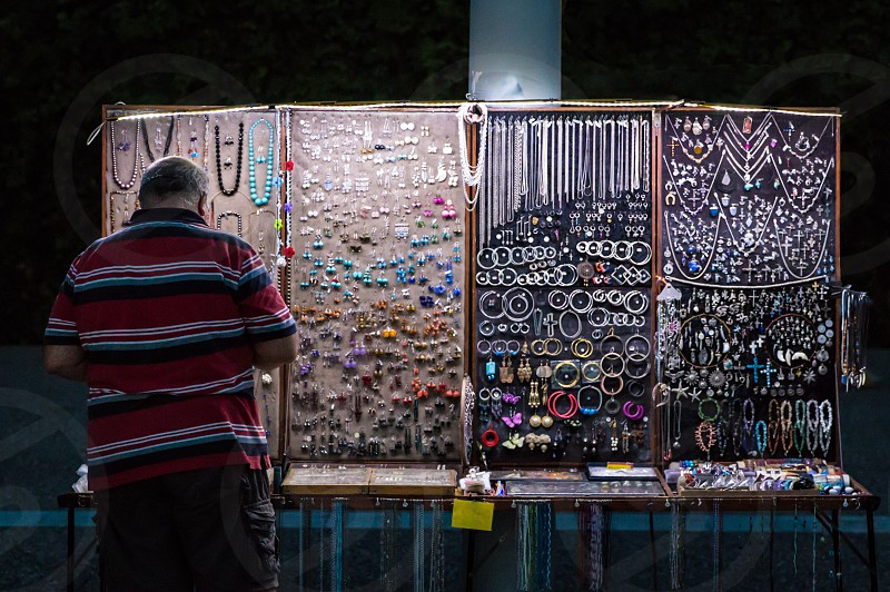 Street Seller Of Handmade Rings Bangles Earrings And Souvenirs At Night photo