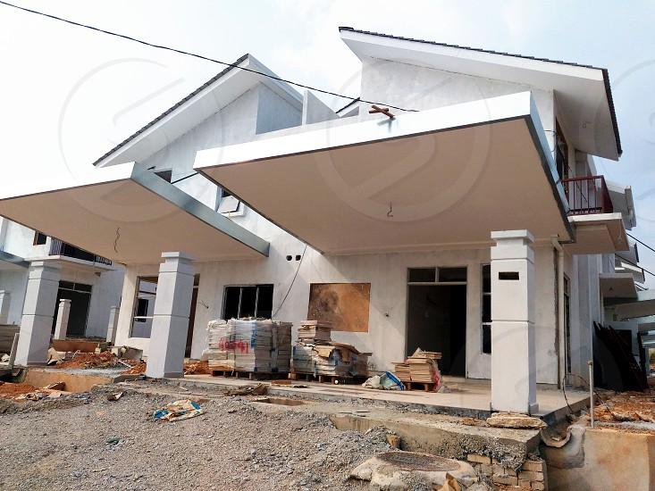 white concrete house during daytime photo