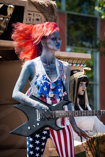 Zombie monster red hair guitar float parade photo
