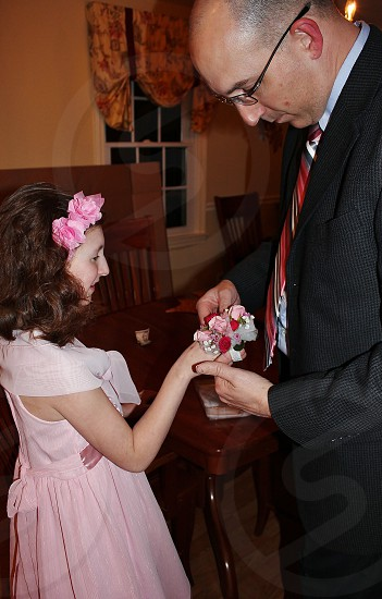 Their first Father/Daughter dance - presentation of the flowers photo