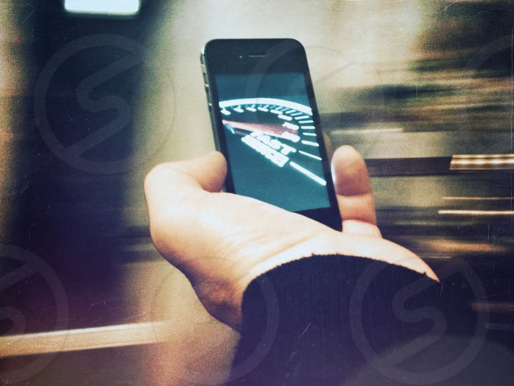 person holding a black iphone  4 photo