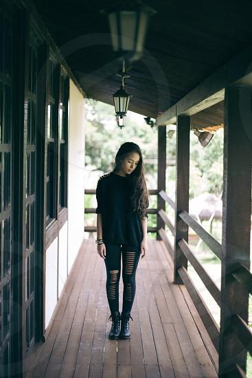 woman standing wearing black sweater photo