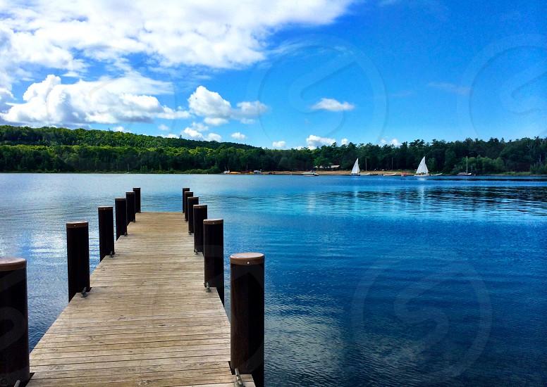 Pier sailboats lake photo