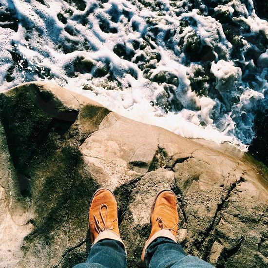 tan rocks and ocean photo