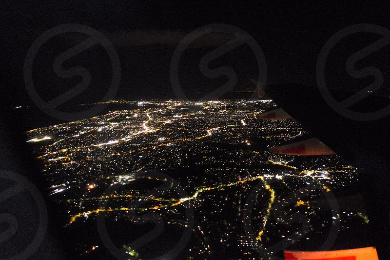 City lights at night from the sky photo