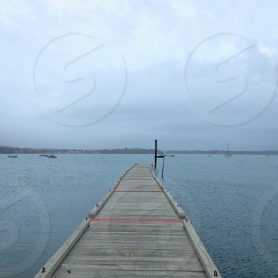 dock on a foggy day dock fog ocean maine autumn boats  photo