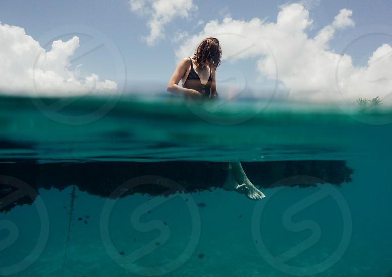Underwater shot of woman's foot photo