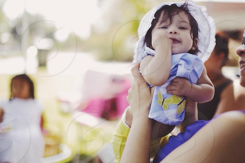 baby girl cuddled photo