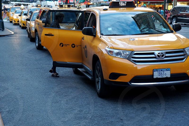 orange taxi cab photo