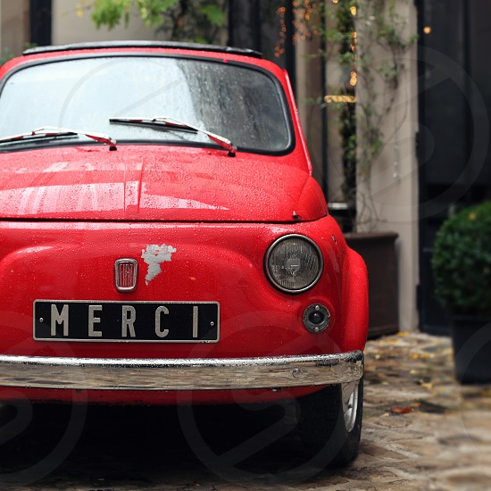 red merci car photo