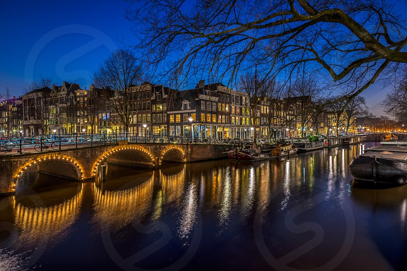 Amsterdam canals and bridge at blue hour. photo