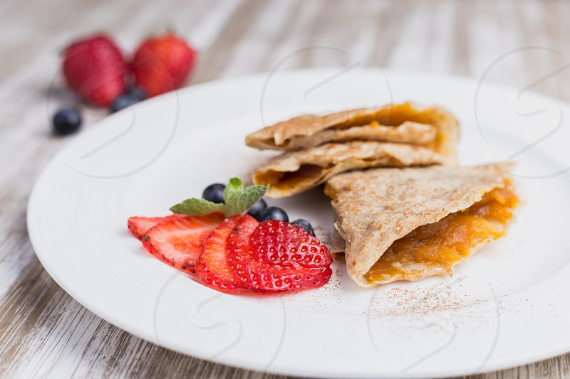 Two marmalade pancake with strawberries photo