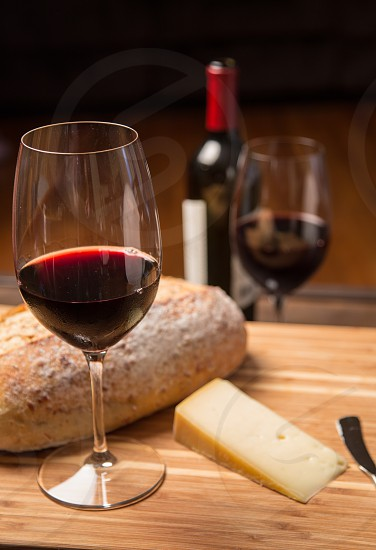 Red wine with bread and cheese in vertical format photo
