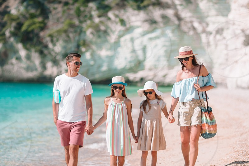 Family of four on beach vacation photo
