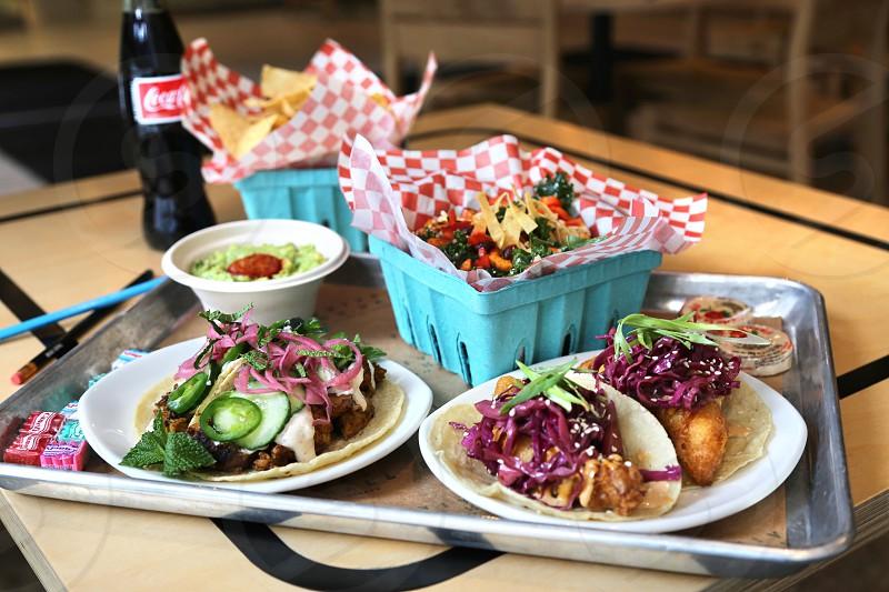 Tacos salad tortilla chips and guacamole  photo