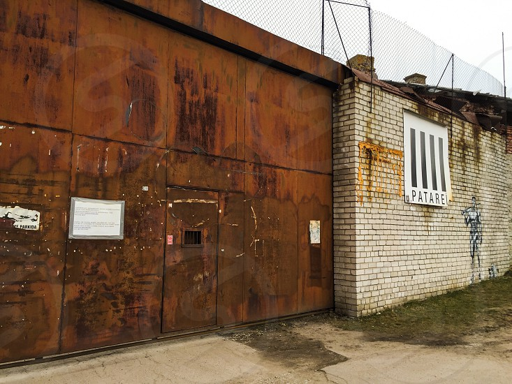 Outdoor day horizontal colour prison patarei Tallinn Estonia metal rust door brick incarceration photo