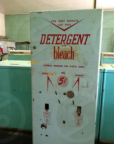 white Detergent and Bleach vending machine photo